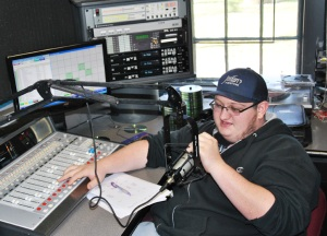 The student-produced and operated radio station features both music and talk. Junior communication major Chris Haskell works the mic during an afternoon session. // PHOTO BY NICK IRONSIDE