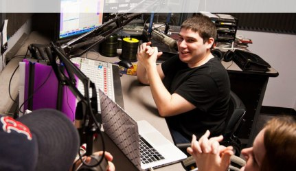Alex Danahy, a senior communication major, sits in Studio A at WMLN, Curry's student-run radio station. // Photo courtesy of Curry College