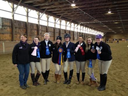 The victorious Curry Equestrian team. From left to right: Coach Betsy Kupic, Emma Ripatrazone, Kelsey O'brien, Alyssa Konstantino, Chelsea Cotton, Courtney Tourcotte, Jamie DeBenedictis, Katelyn O'toole. Not pictured: Katy Longchamp, Kat Doering, Samantha Weintraub.