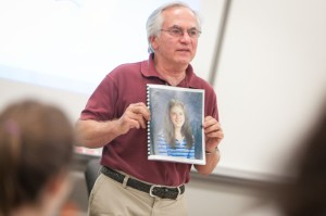 Ron Bersani holds a picture of his granddaughter, Melanie Powell, who was killed in a drunk driving accident in 2003. // PHOTO BY CONNOR GLEASON / CURRY COLLEGE.