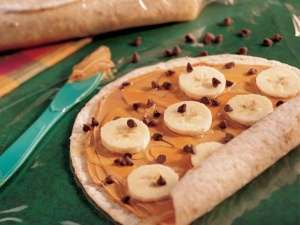 Take a soft tortilla, add peanut butter, banana slices and chocolate chips, then roll. It's sweet, modestly healthy, and good.