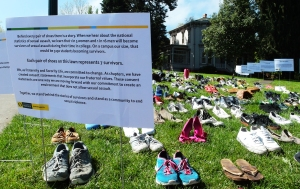 Each pair of shoes represents seven survivors of sexual assault. PHOTO BY WOLFRAM BURNER, CREATIVE COMMONS.